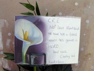 A card on a floral tribute left on the Chorley Pals Memorial after the funeral