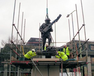 Steve Williams watches as the statue is lowered onto the plinth