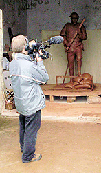 A BBC cameraman filming the statue in May 2009