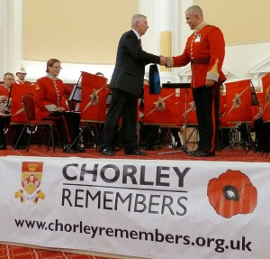 Presentation by Lindsay Hoyle MP to Bandmaster Craig Philbin