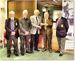 Steve Williams (centre) receives the cheque from Association Chairman, Cllr. Eric Bell watched (left to right) by Stan Dickinson (Association Secretary), John Garwood (Chorley Pals Trustee) and Laurence Perry (Association Treasurer).