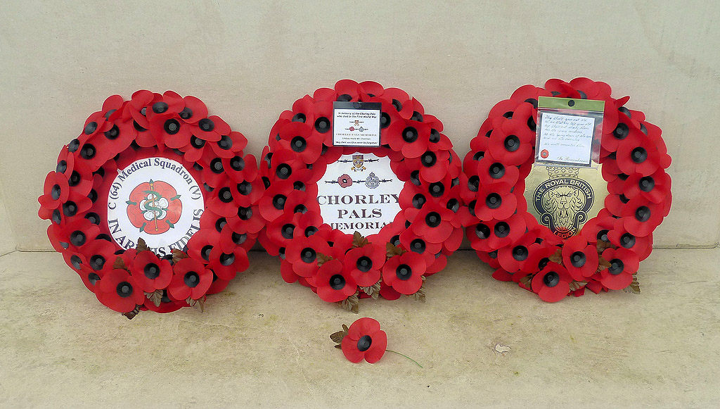 The wreaths laid at the base of the statue