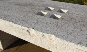 Damage caused to the plinth, believed to have been caused by skateboards or scooters