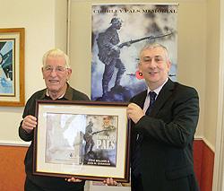Lindsay Hoyle presents John Garwood with a framed copy of the 'Chorley Pals' book cover, 4th December 2009
