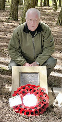 Steve Williams lays a wreath by the Chorley Pals plaque in the trenches at Serre